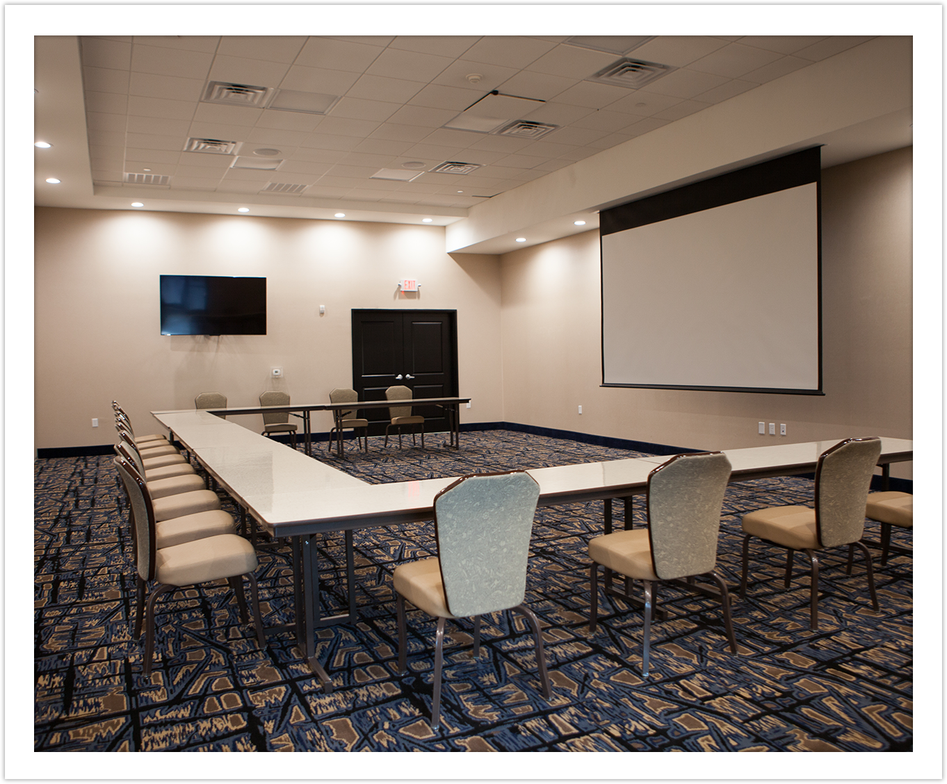 Image of Conference Room with Projector at Arbor Hotel and Conference Center Lubbock Texas